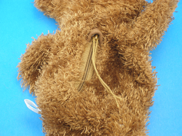 Closed zipper located on the rear of each bear. You can cut off the string on the zipper.