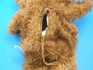 Open zipper located on the back of each bear.